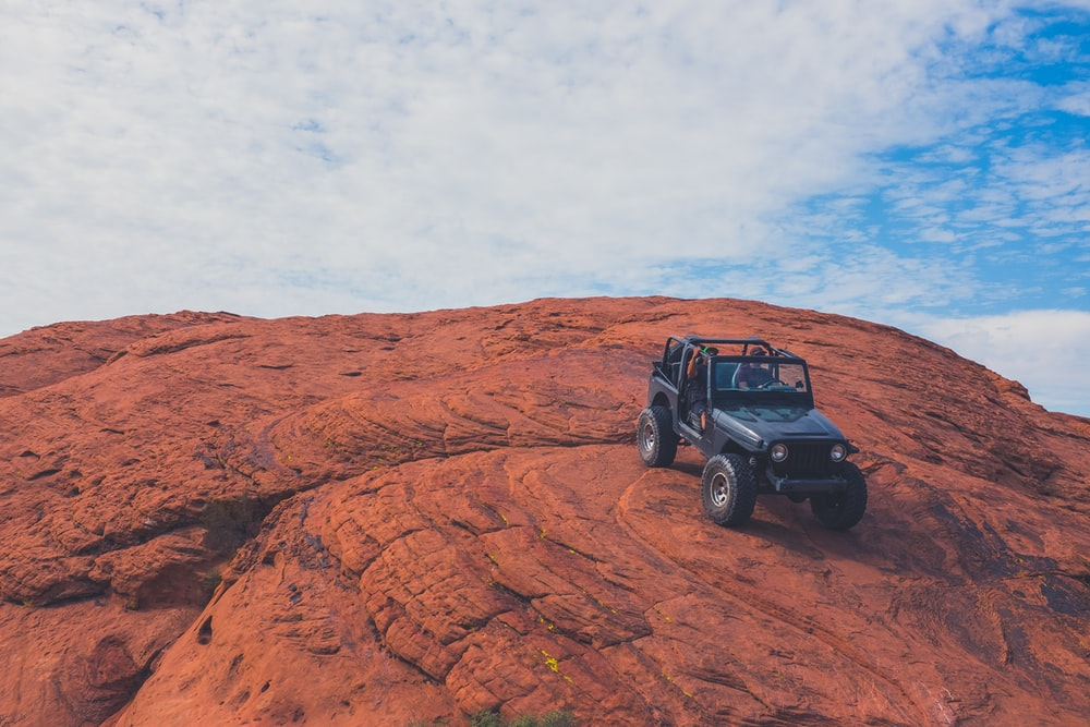 black Jeep Wrangler on hill