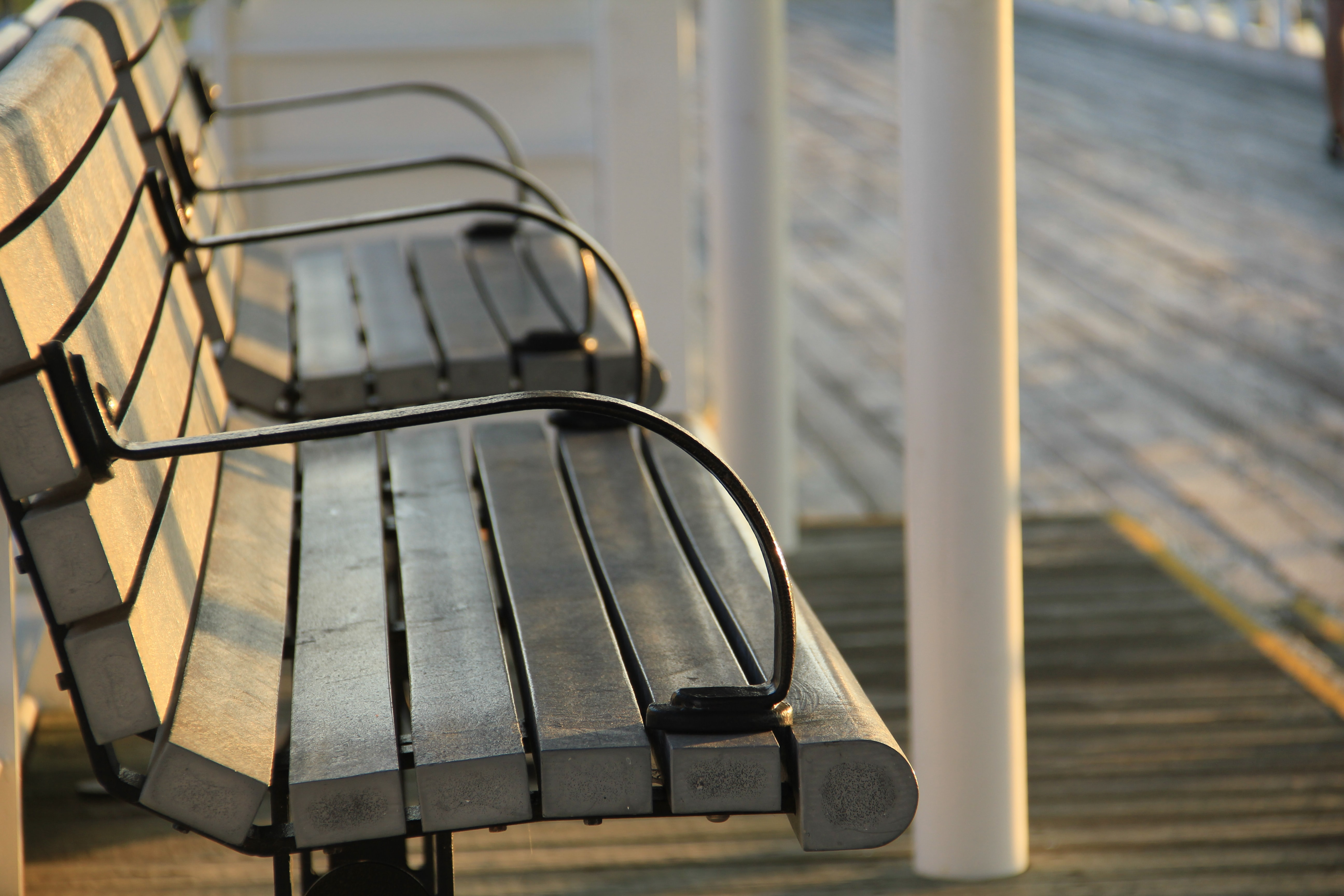shallow focus photography of grey wooden benches