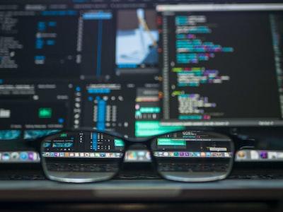 closeup photo of eyeglasses tech zoom background
