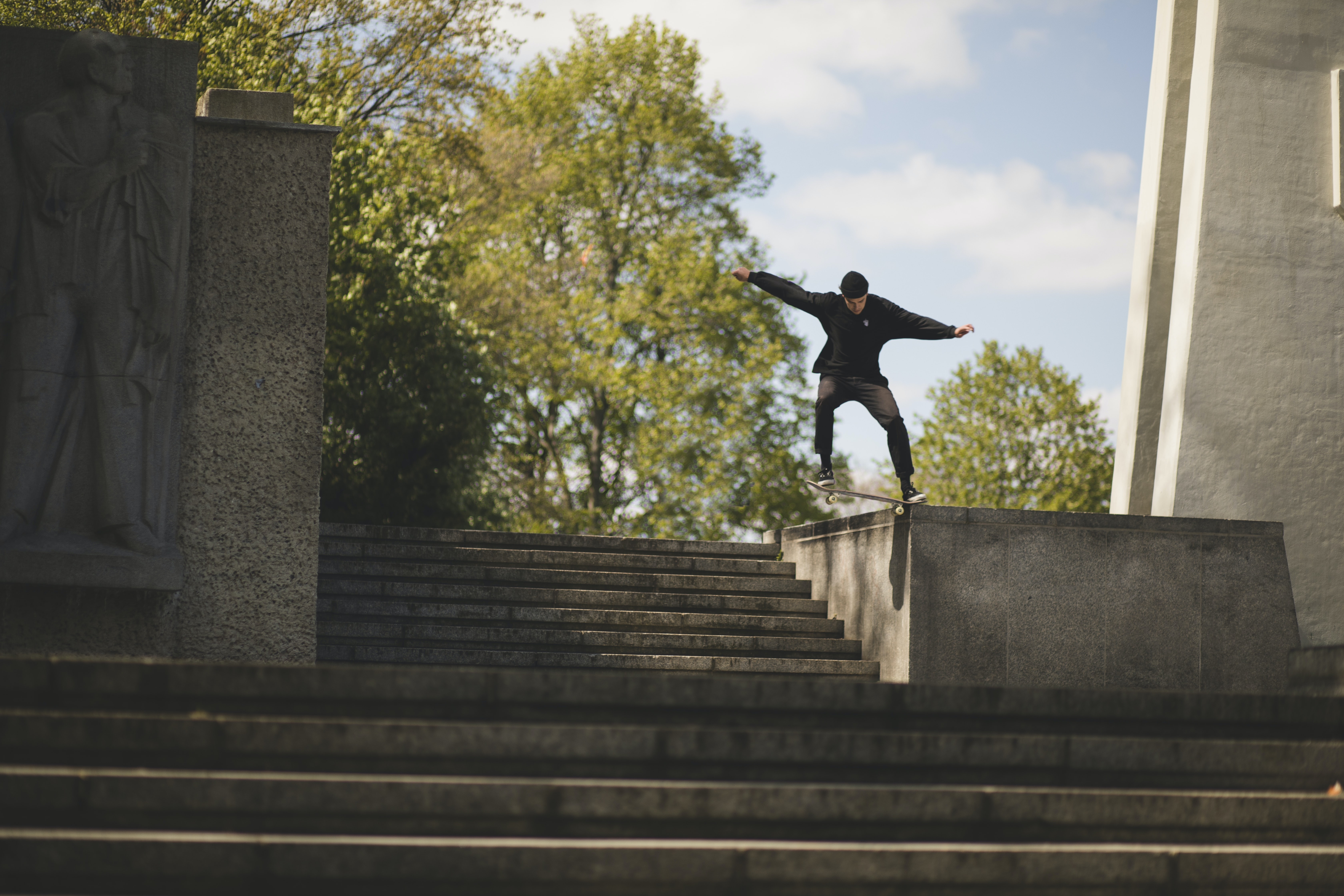 man riding on skateboard while doing nose grind trick