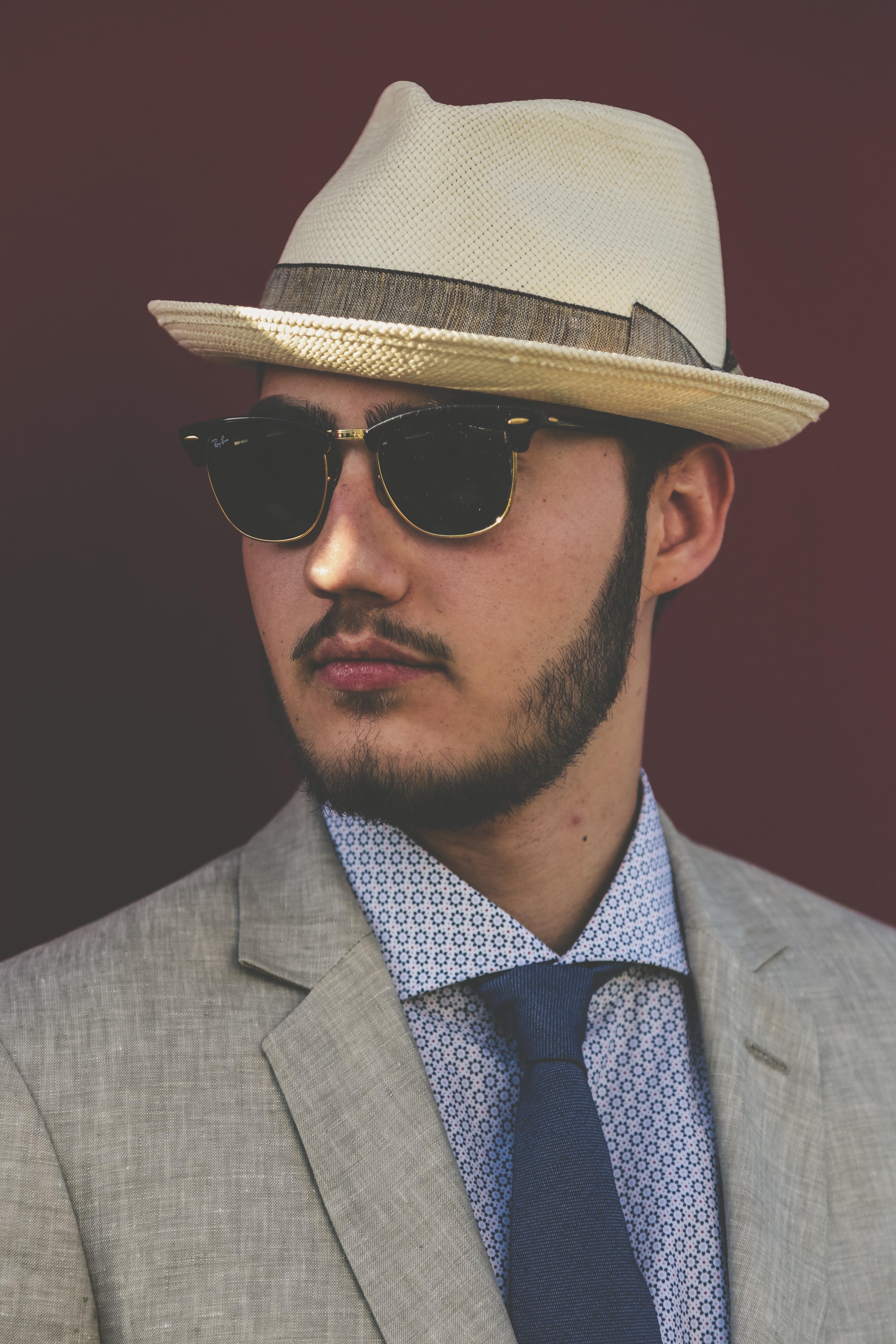 man wearing grey coat and beige fedora hat