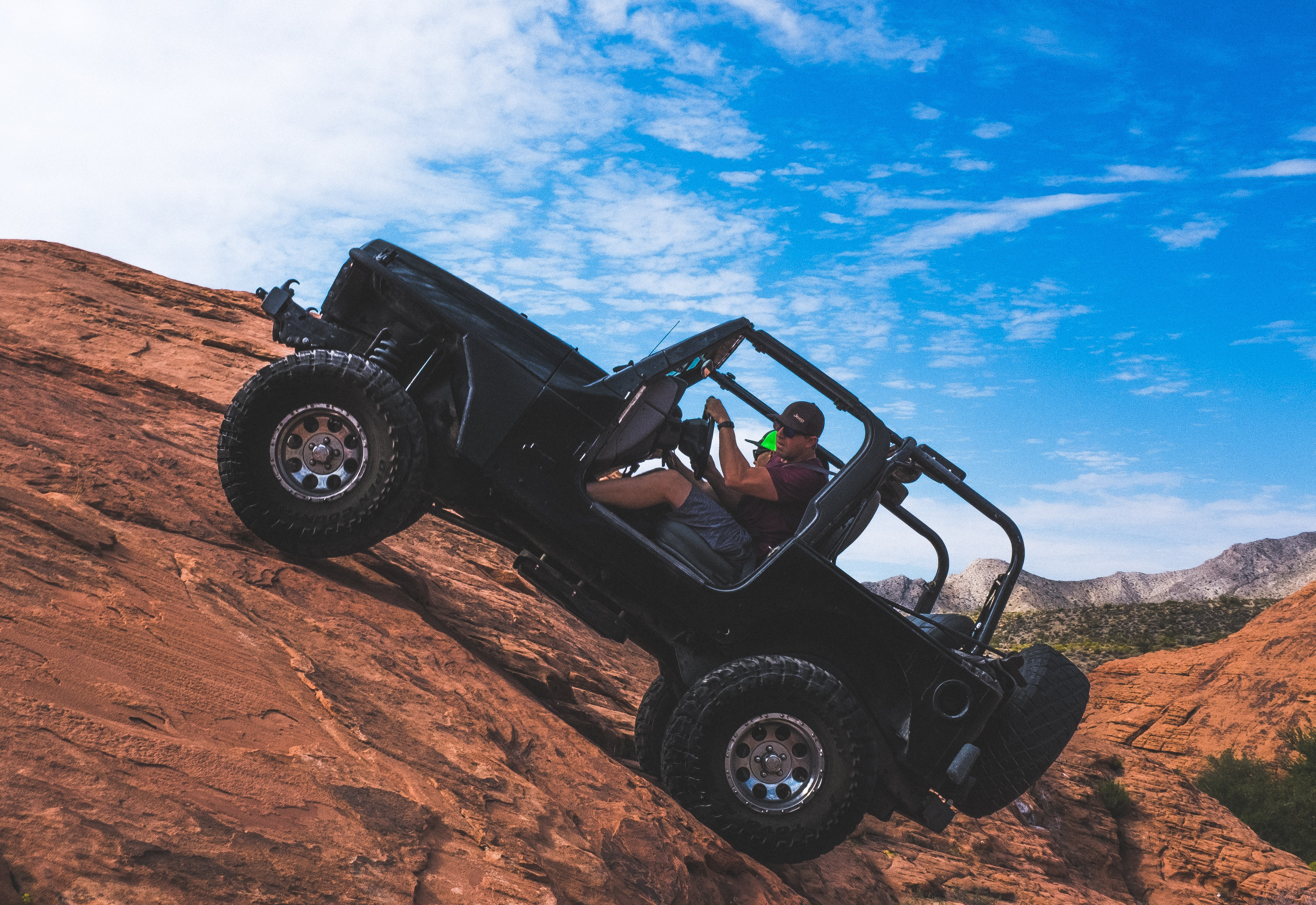 man riding a black off-road vehicle