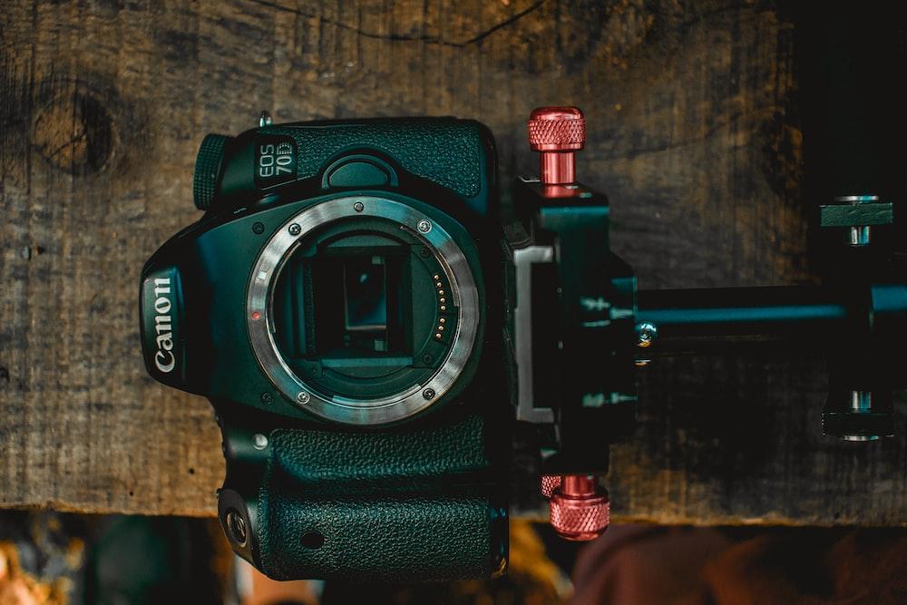 black Canon EOS 70D on table
