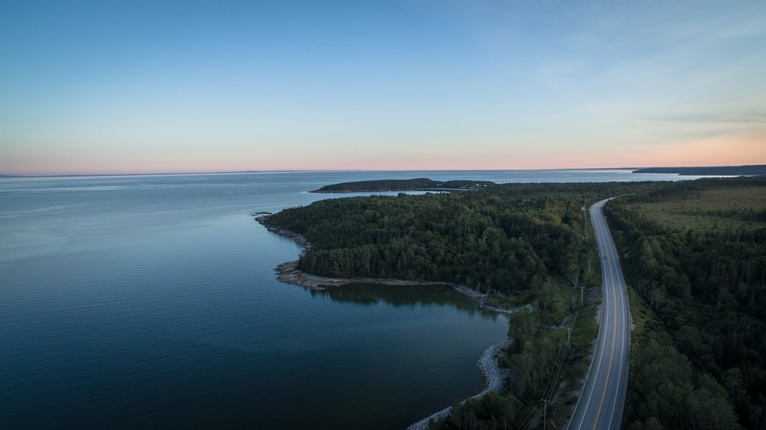 - Part of a 30 days streak of Unsplash uploads -  This photo dates back from my road trip on the North Shore in Québec in 2015. As we were trying to go as up north as possible for a chance to catch some northern lights, we stopped by a rest area by the road and by the river.  I had had my DJI Phantom 3 Pro for only a couple of weeks, but was already in love with my new tool.  The majestic landscapes only got more breathtaking when taken from dozens of feet up in the sky.  Jp Valery is one of the best photographers in Montréal, QC and can be contacted at contact@jpvalery.photo.
