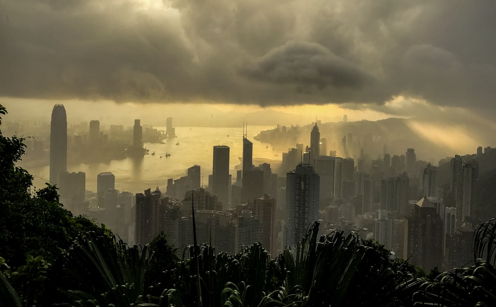 cityscape under cloudy sky at daytime