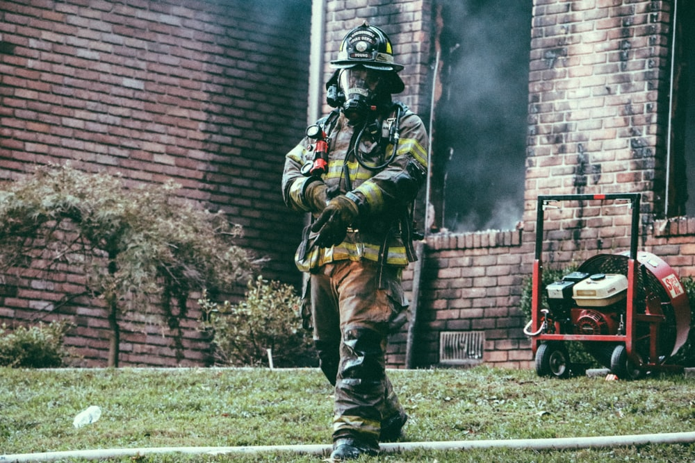 firefighter putting out fire