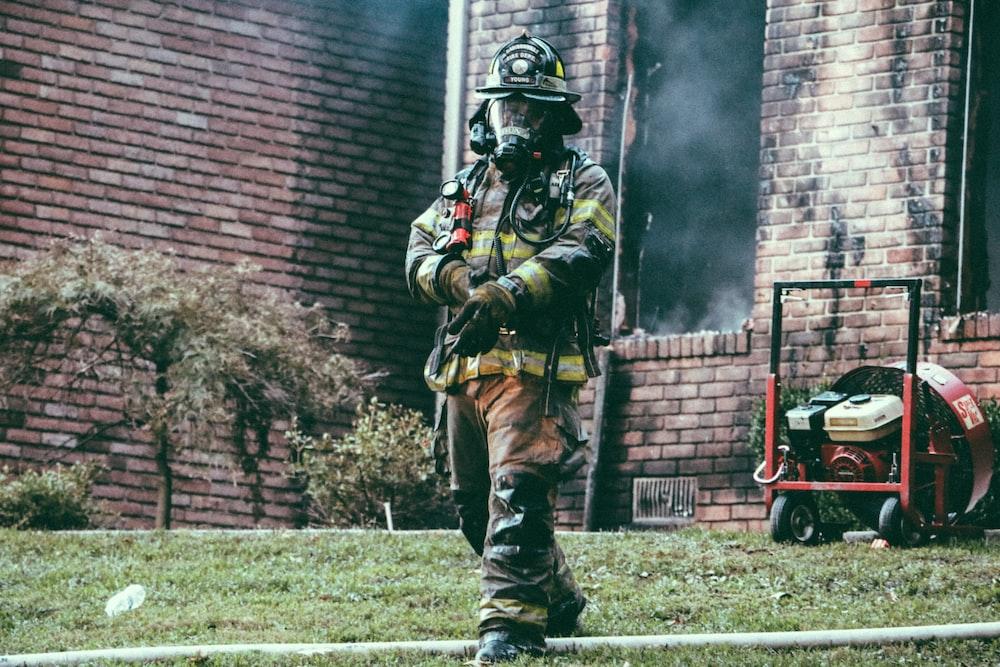 fireman holding his hand