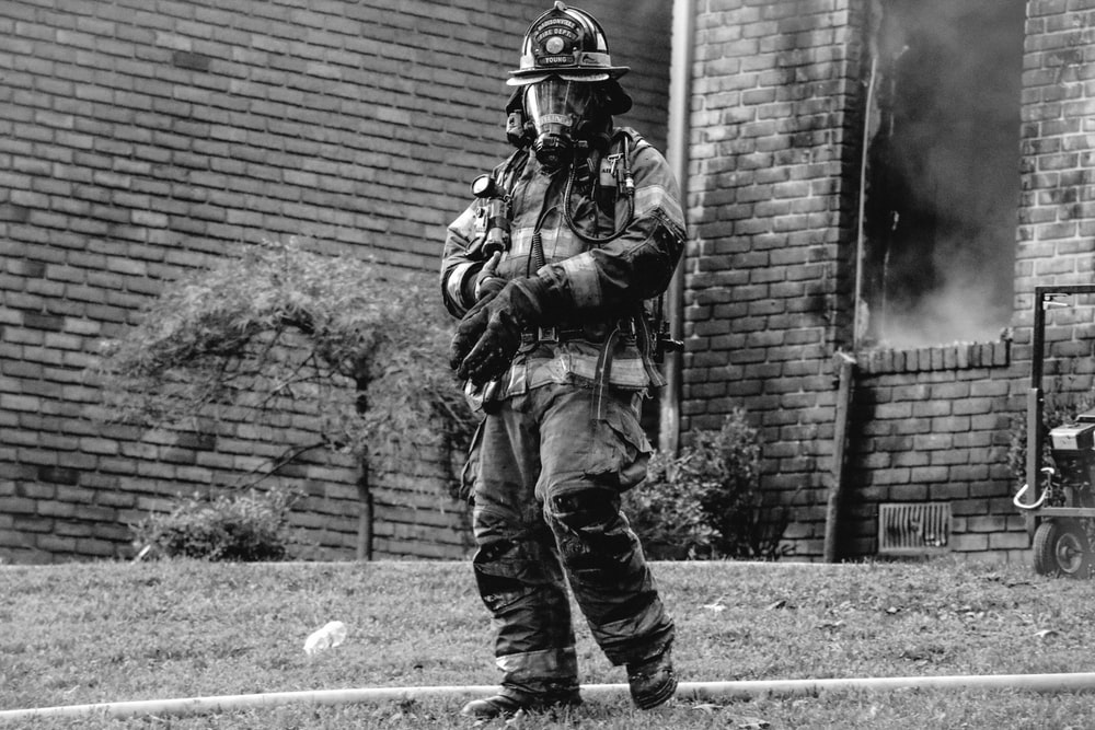 grayscale photo of firefighter