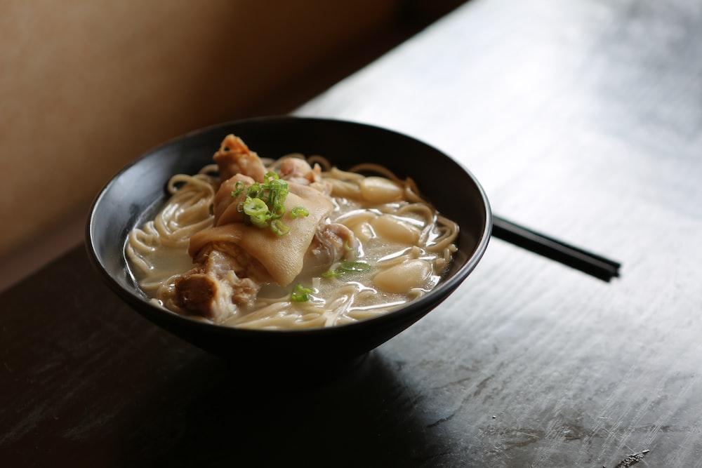 noodles served on black bowl on table