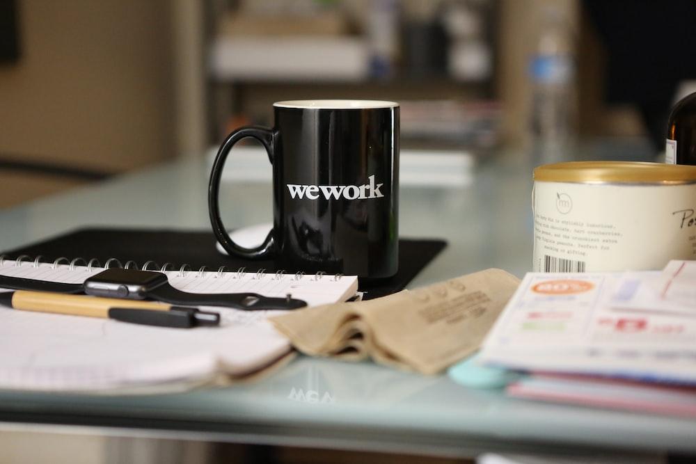 black ceramic mug on book