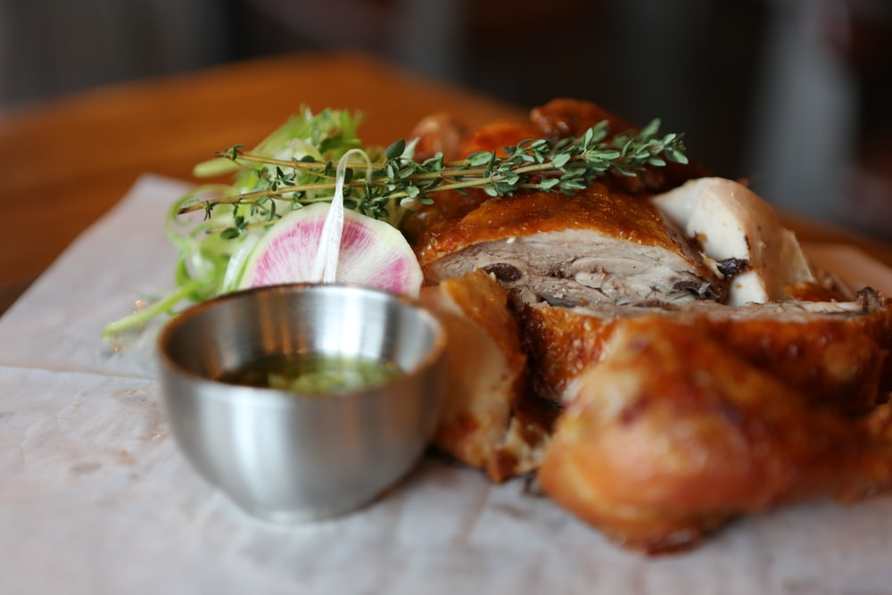 stainless steel bowl and roasted chicken