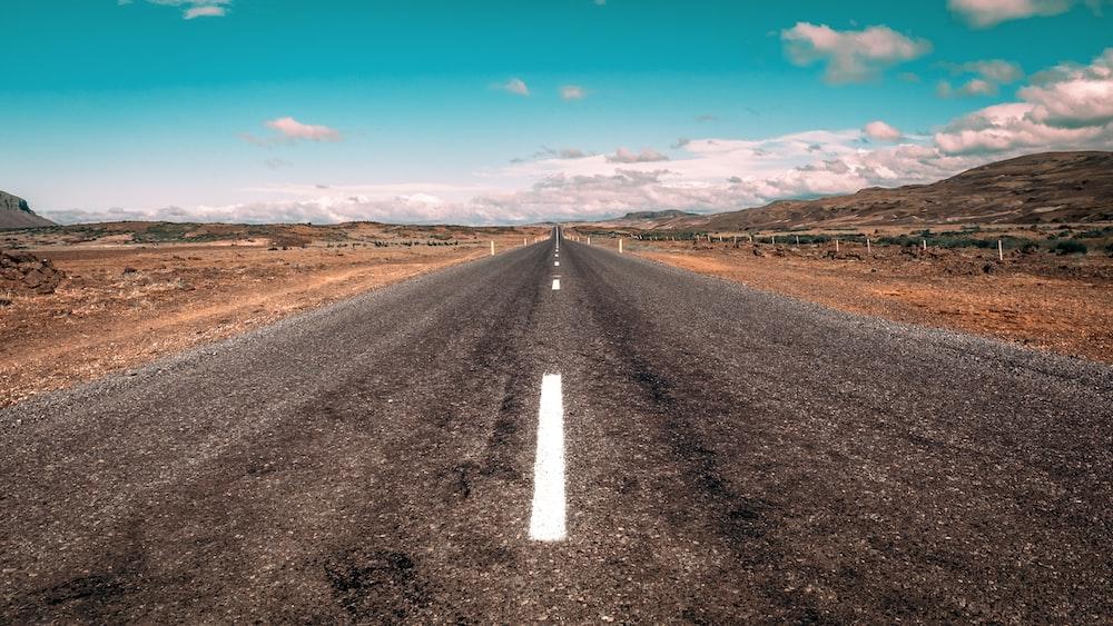 grey concrete road during daytime