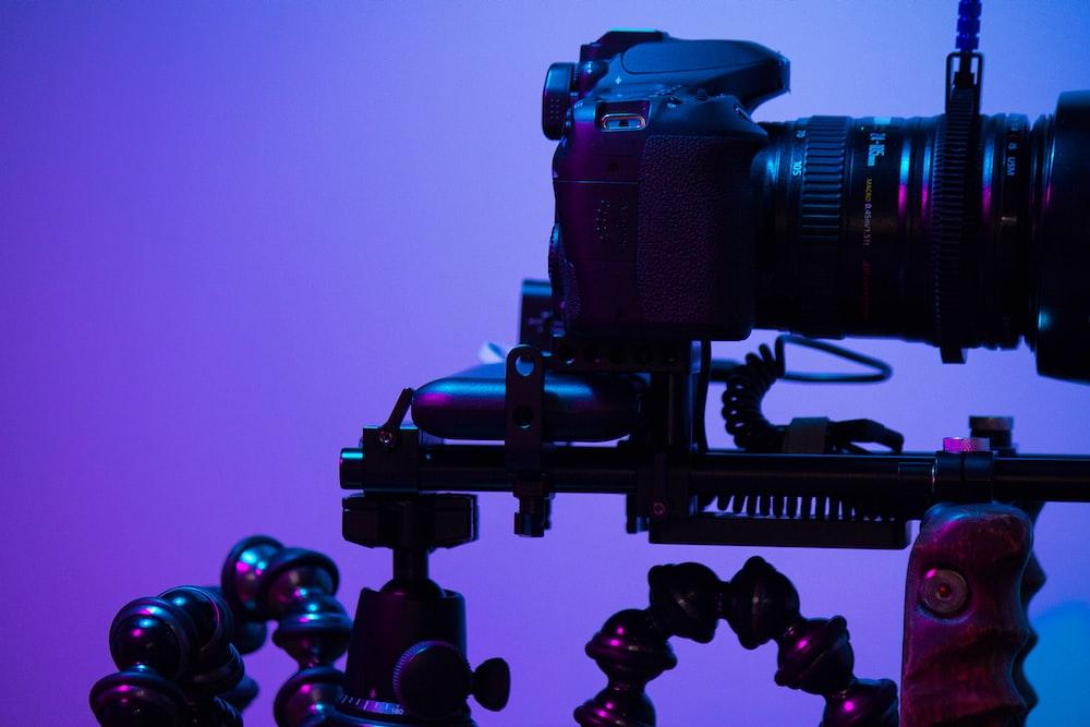 black DSLR camera with camera slide