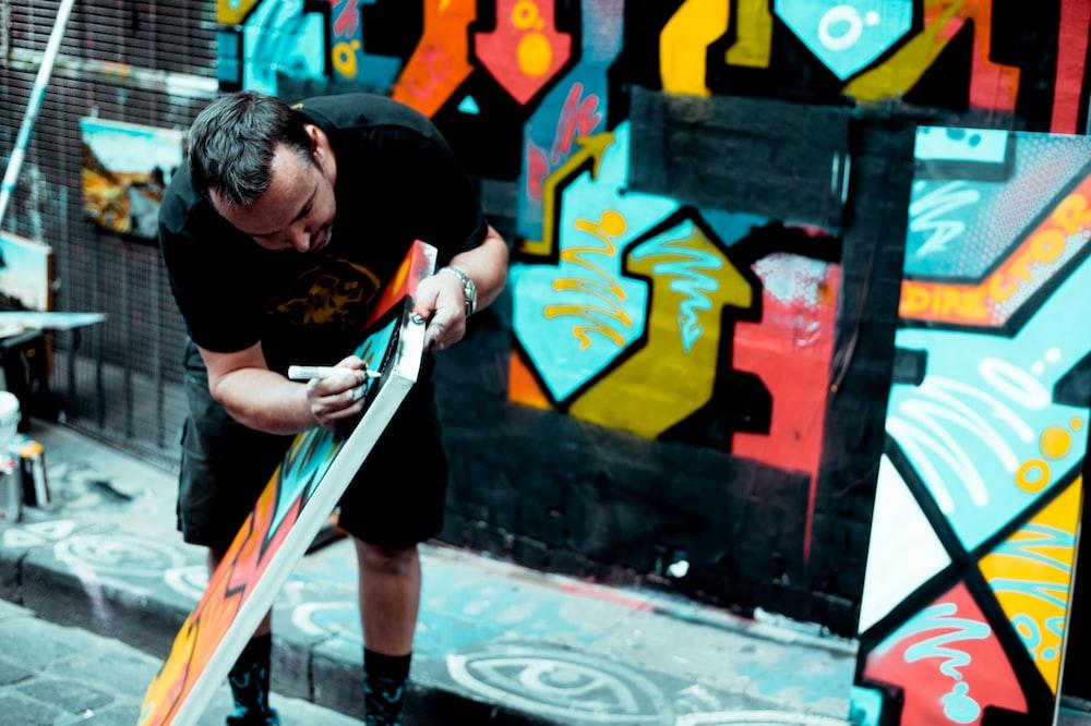 man doing graffiti