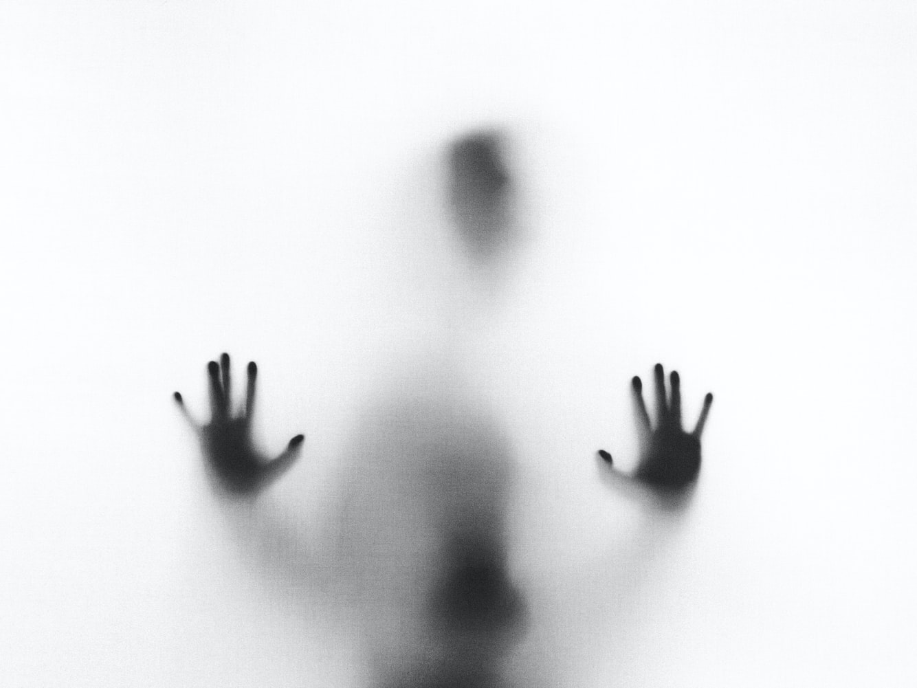A human silhouette against a white background