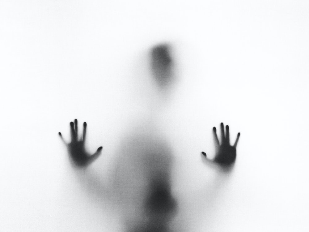 person behind fog glass