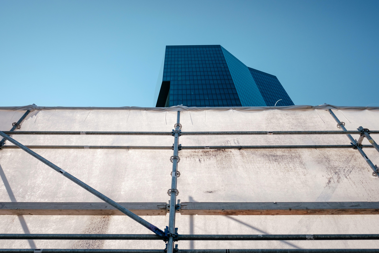 low angle photo of gray metal scaffolding