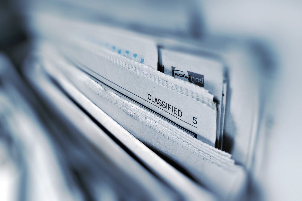 Classified page 5 newspaper selective focus photography