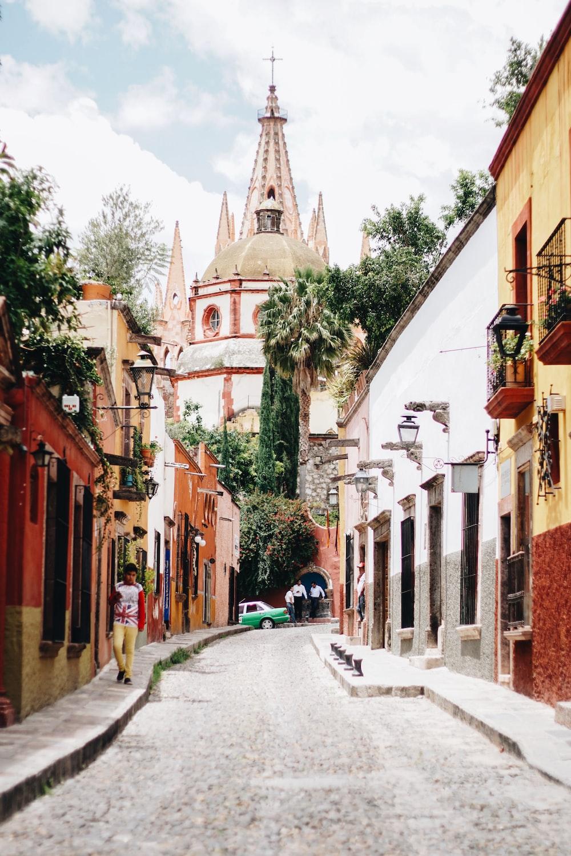 narrow road heading toward church