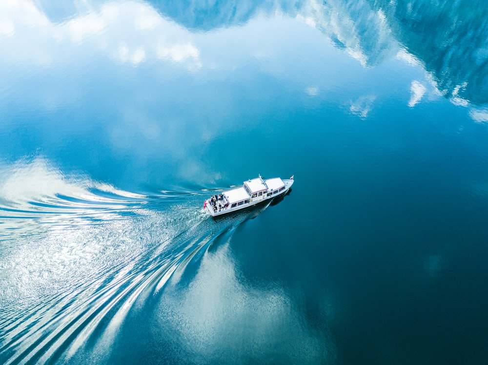 bird's-eye photography of white boat