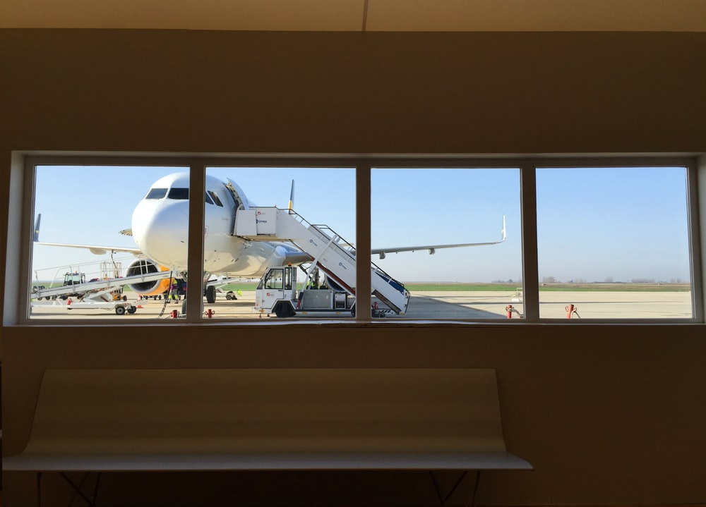 white truck beside white airplane