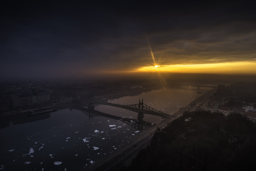aerial photography of bridge on top of body of water at golden hour