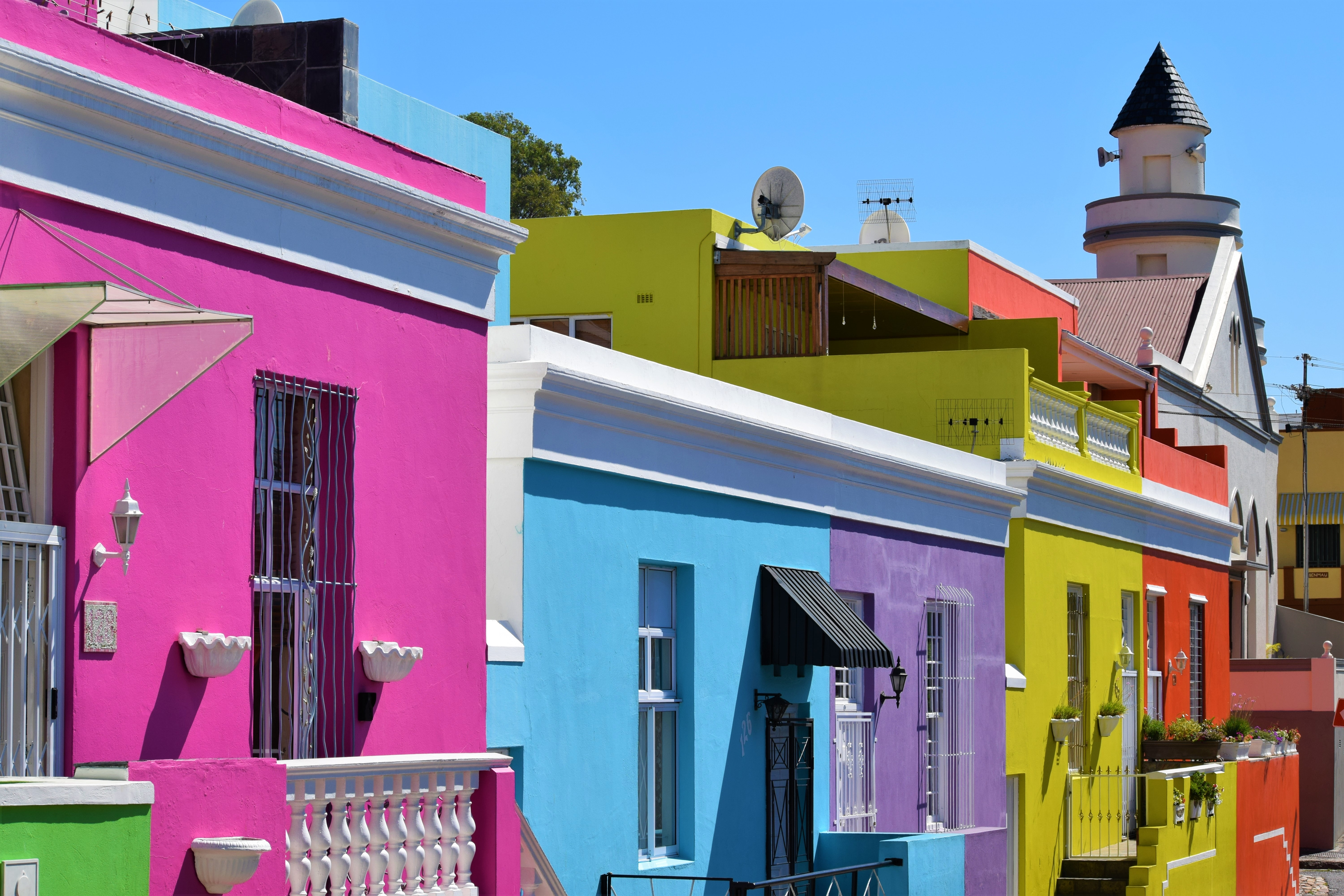 assorted-color painted houses in city