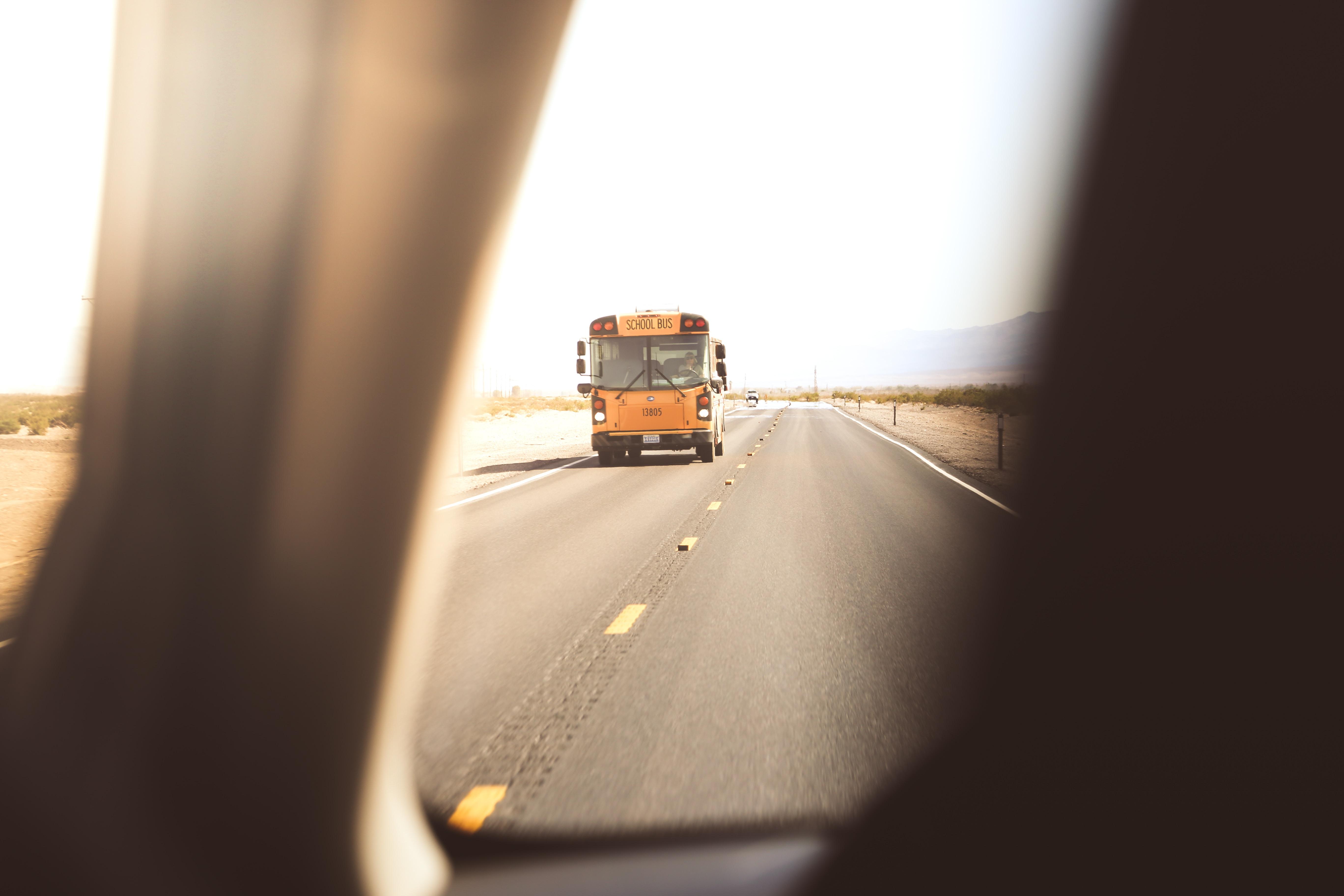 yellow class a motorhome on roadway