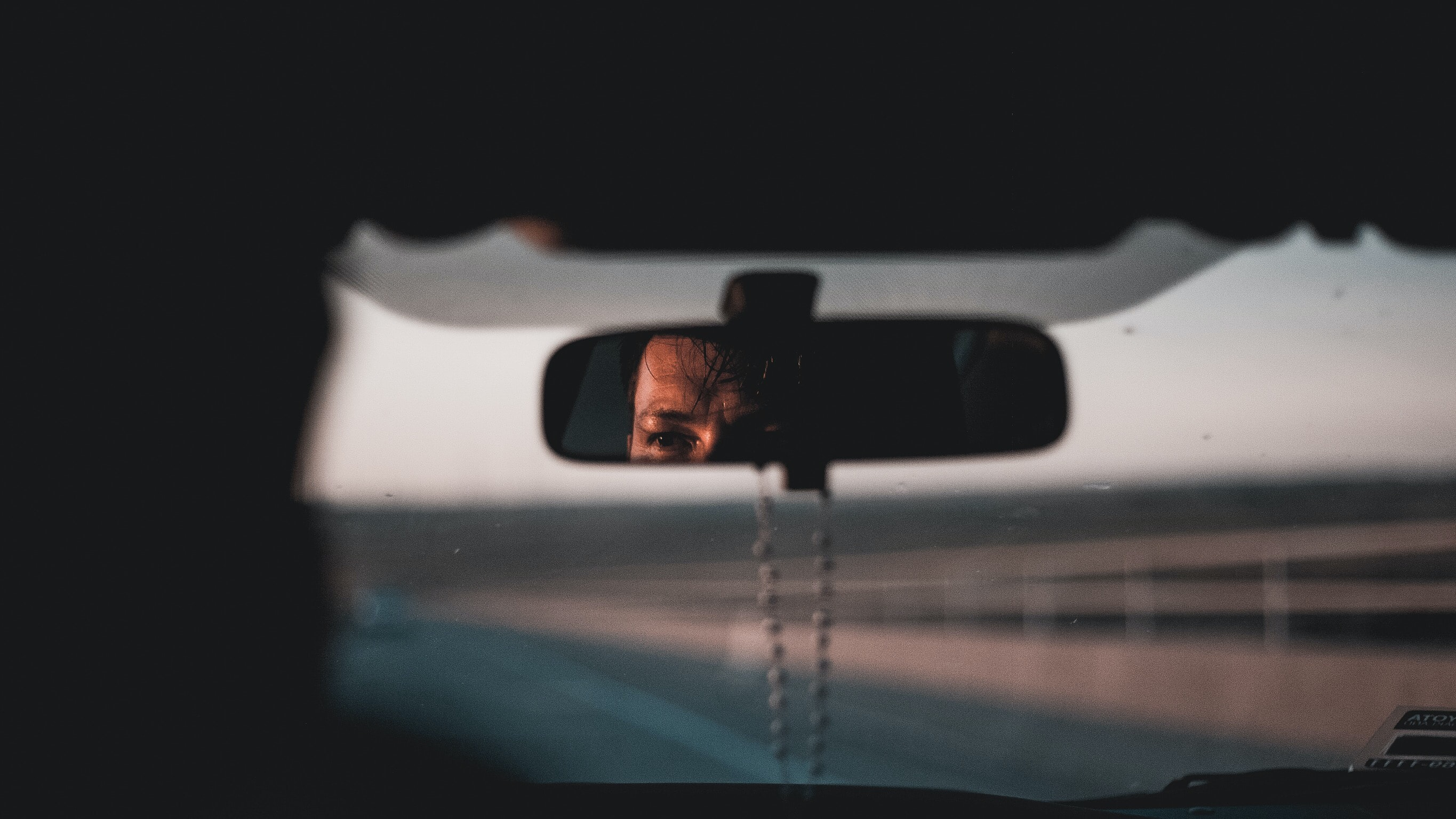 photo of black framed vehicle rear-view mirror