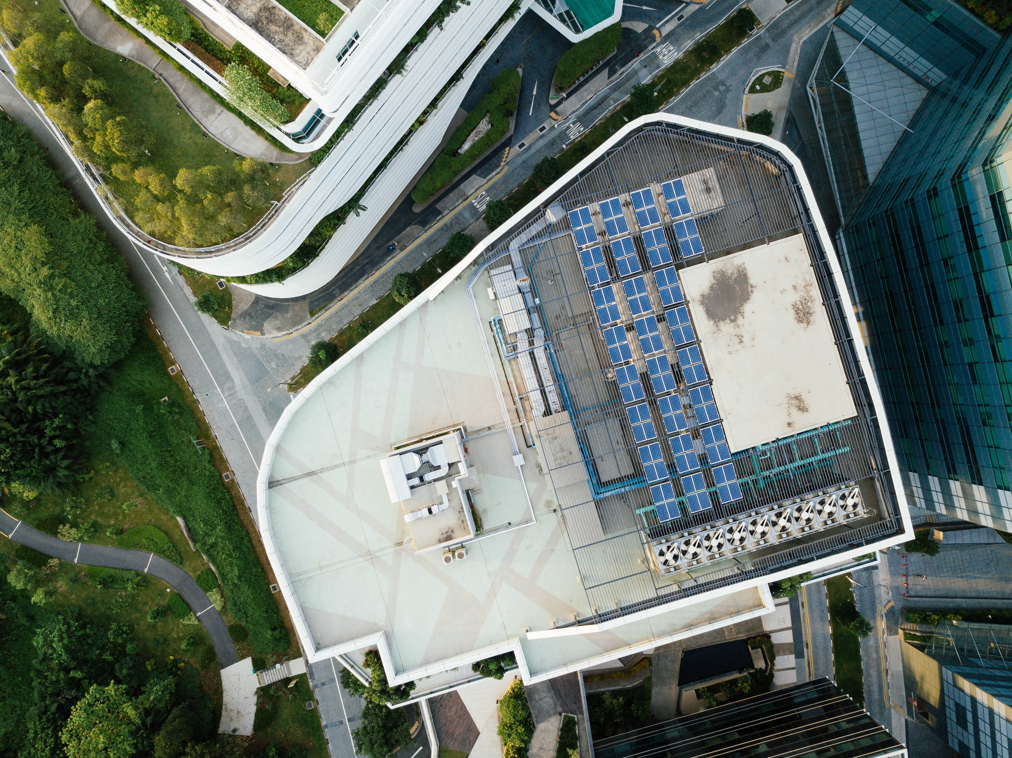 aerial photography of solar heater on building rooftop