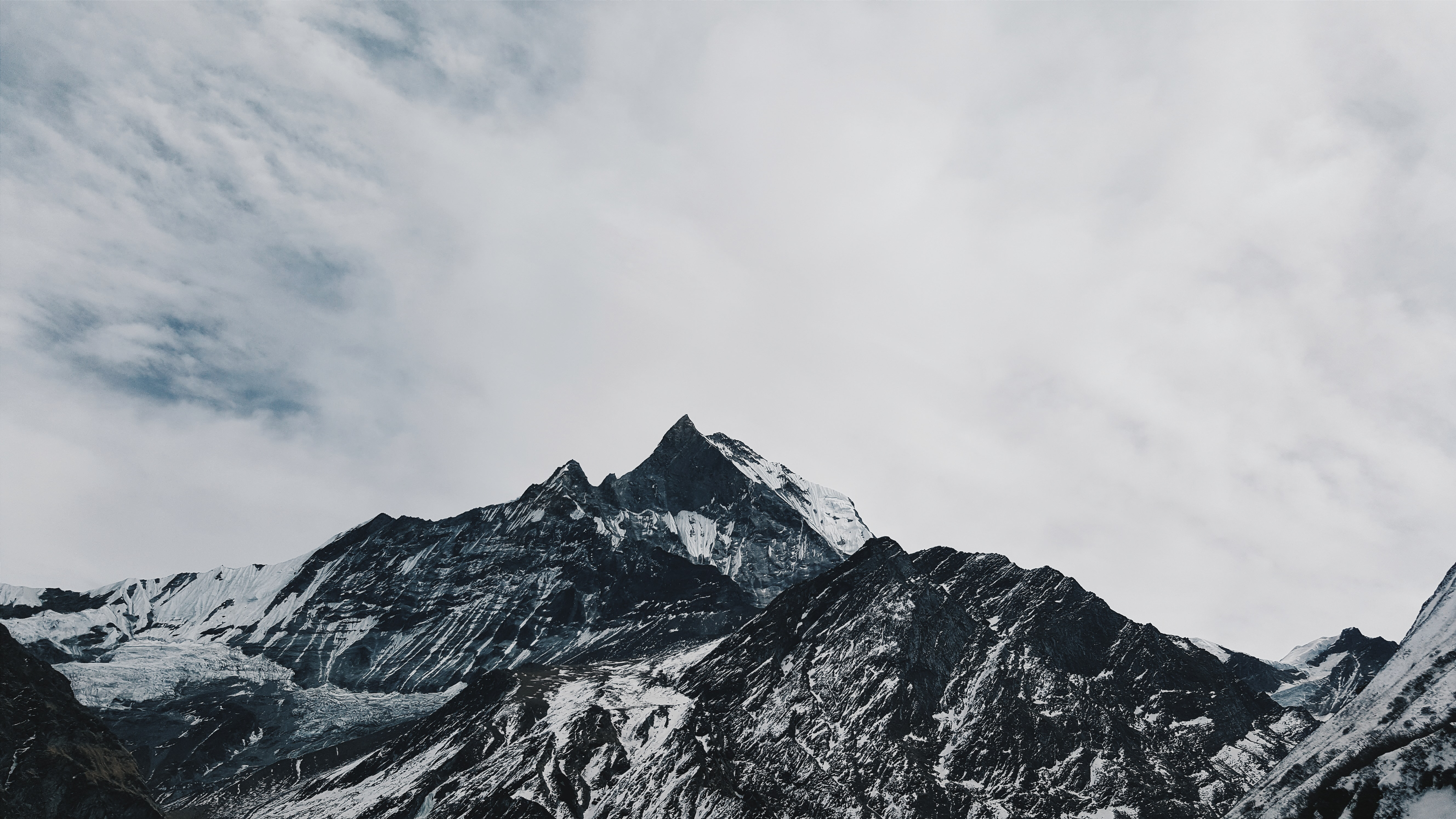snow cover mountain during white cloudy sky