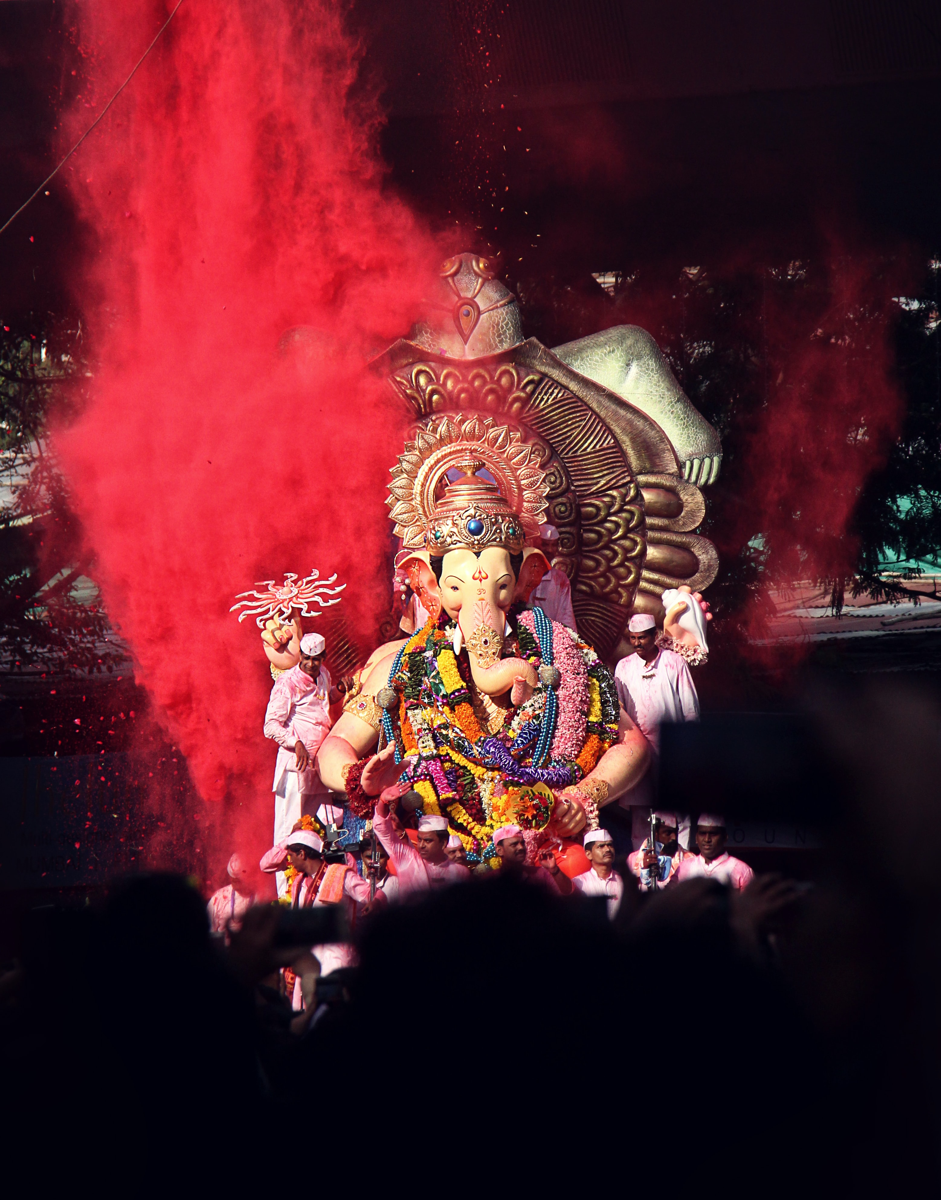 Ganesha statue surrounded by people