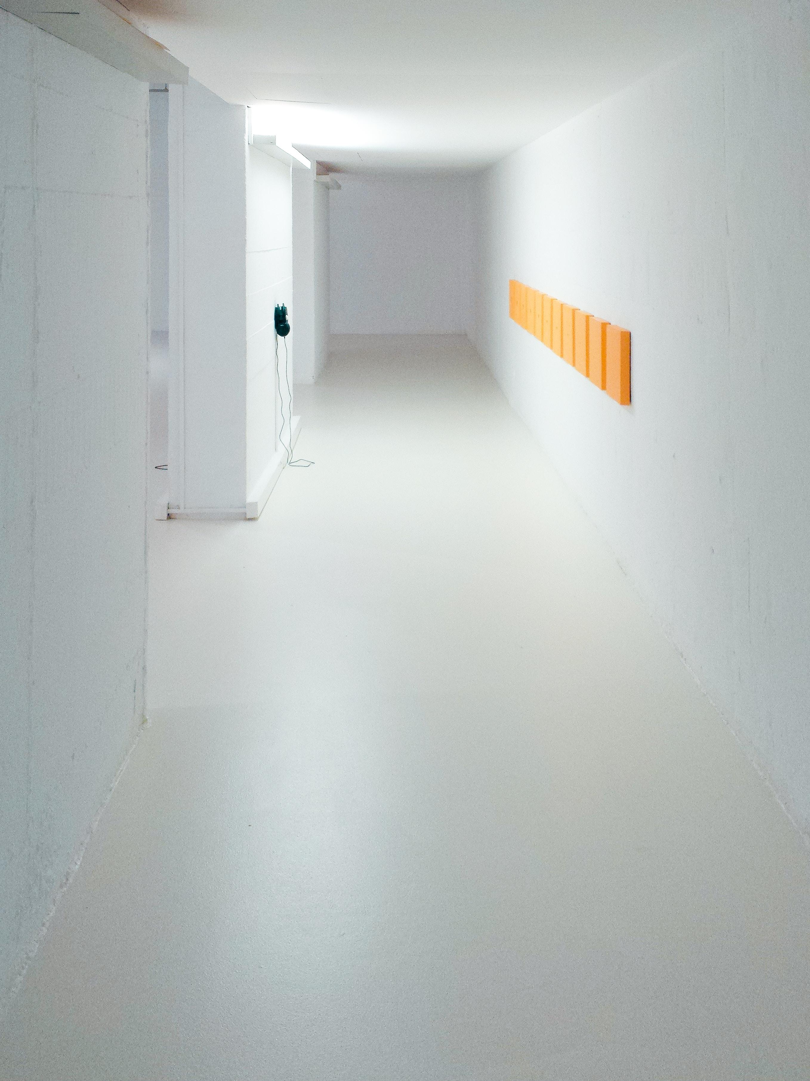 empty hallway between white walls