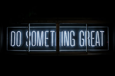 do something great neon sign inspirational teams background