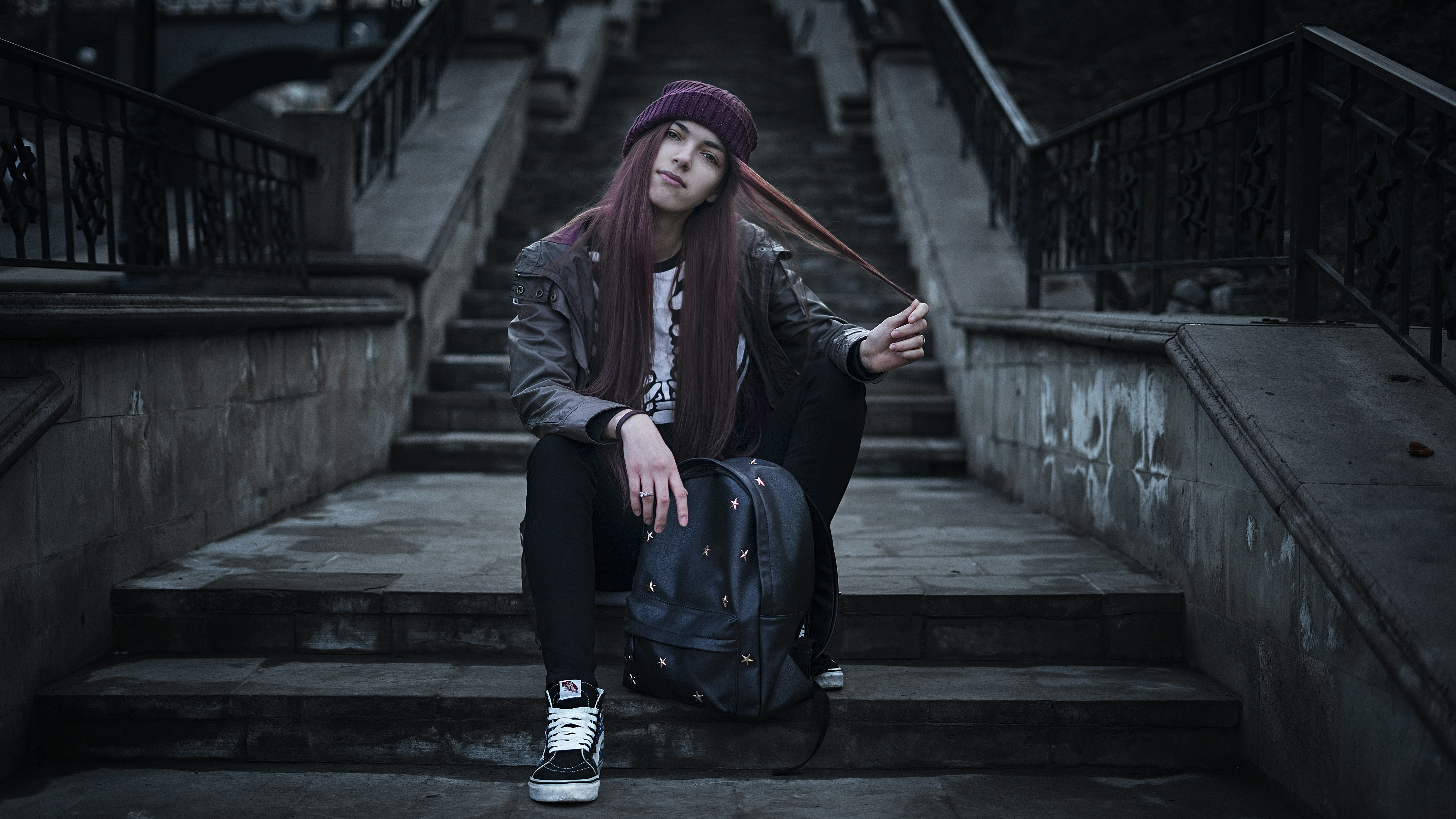 woman sitting on gray cement stair