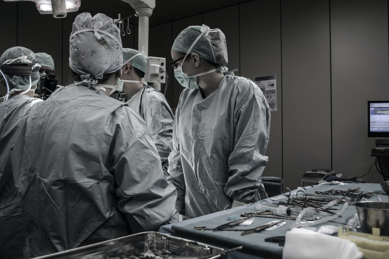 A group of medical personnel having an operation