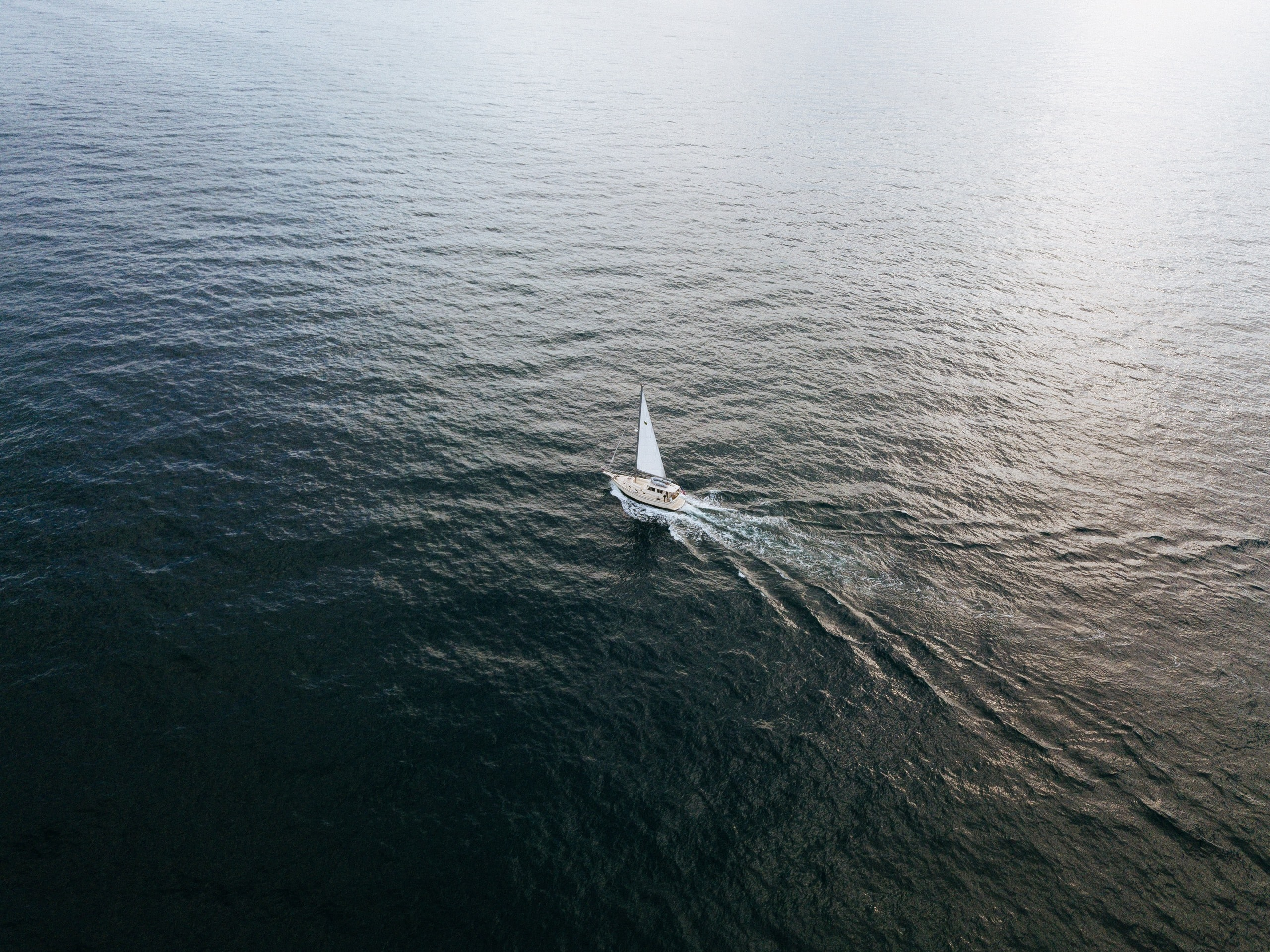 sailboat at the body of water