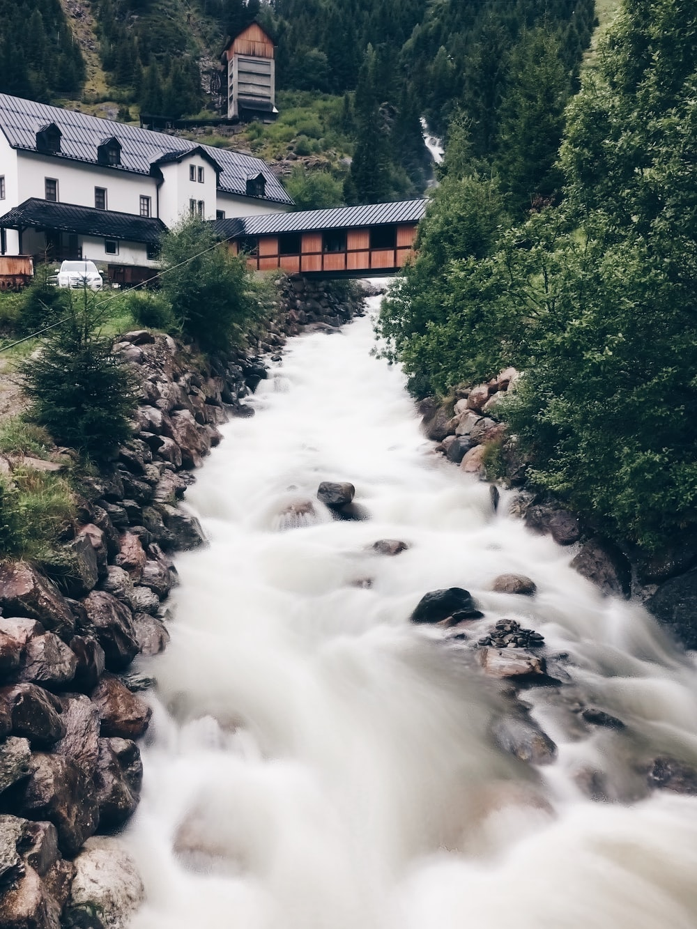time lapse photography of stream near houses