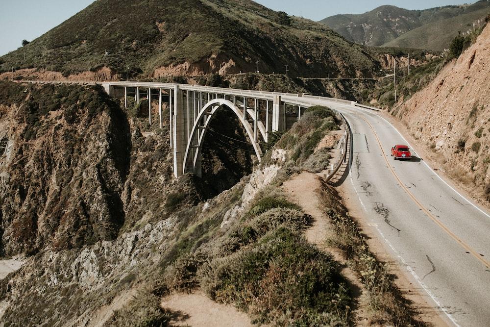red vehicle at the bridge