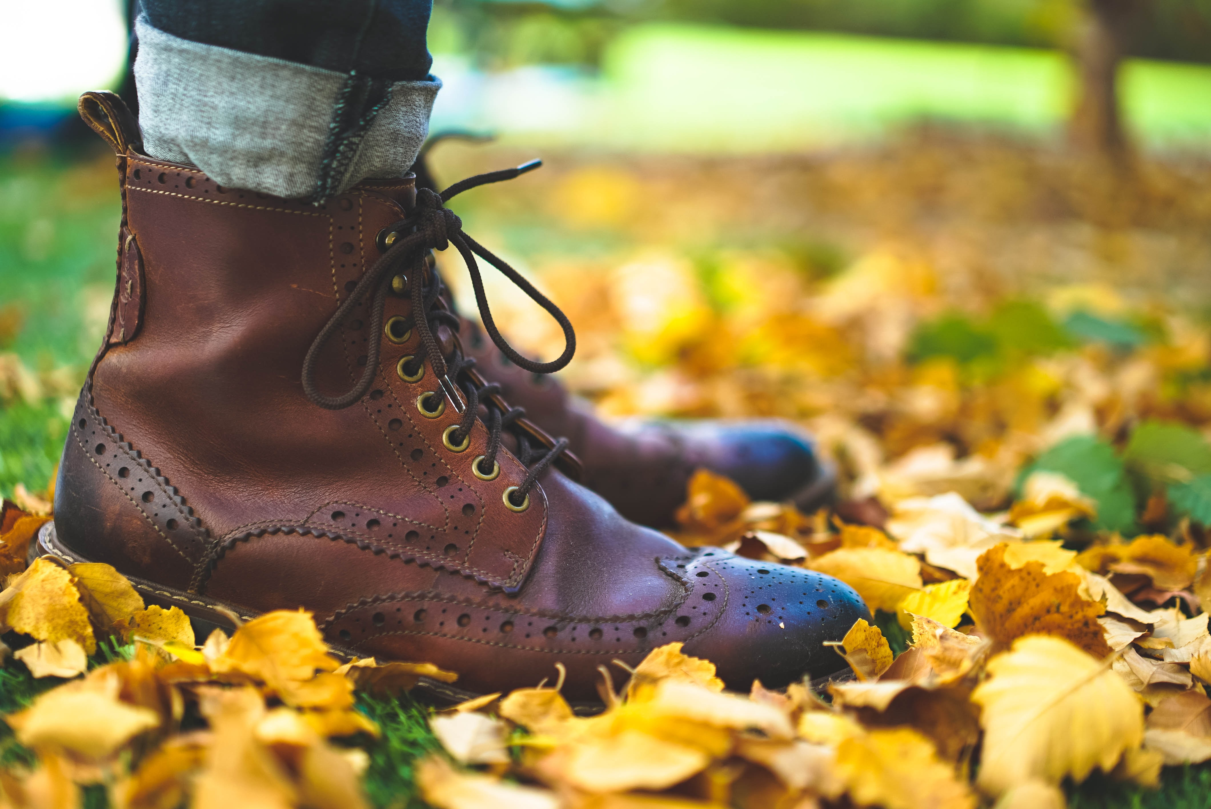 close up photo of person wearing brown leather boots