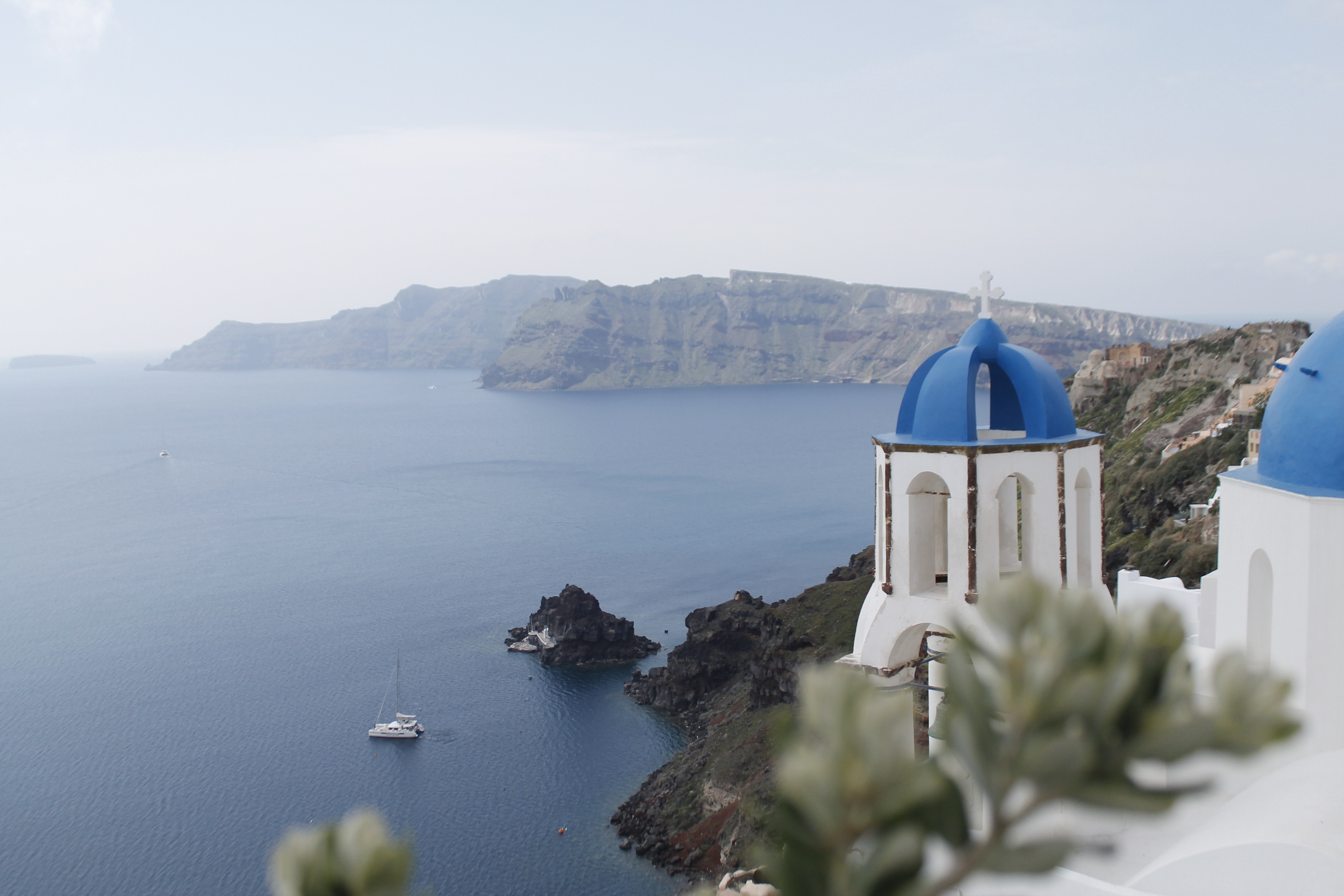 selective focus photography of white-and-blue dome building in Santorini, Greece during daytime