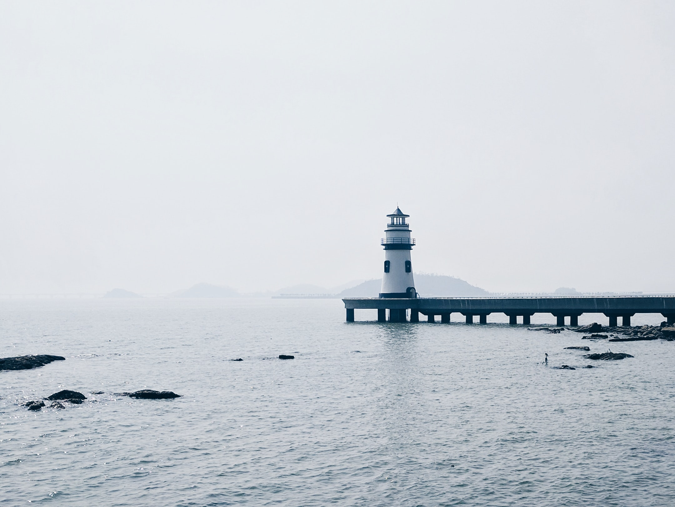 photography of white and black lighthouse