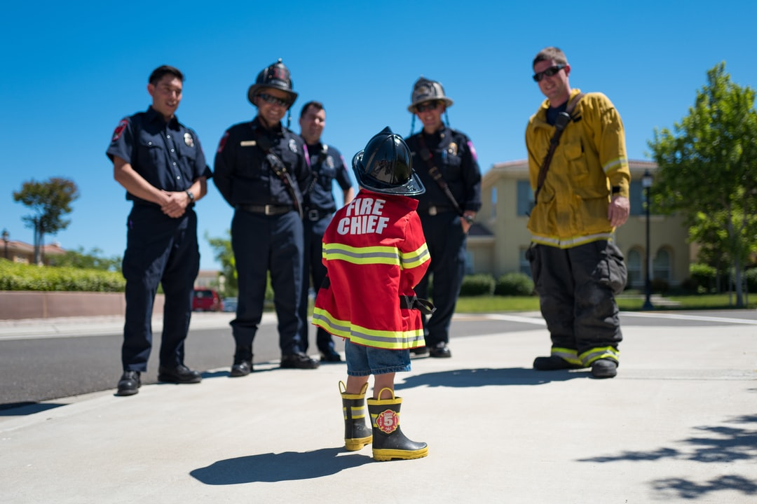 Our local fire department showed up with two firetrucks and in full gear to this three year-old's birthday party. Pretty much the best moment of his life. Here he looks up in awe at all the firemen, right before giving them a big high five. I'm not sure who was happier — the kid or the firefighters.