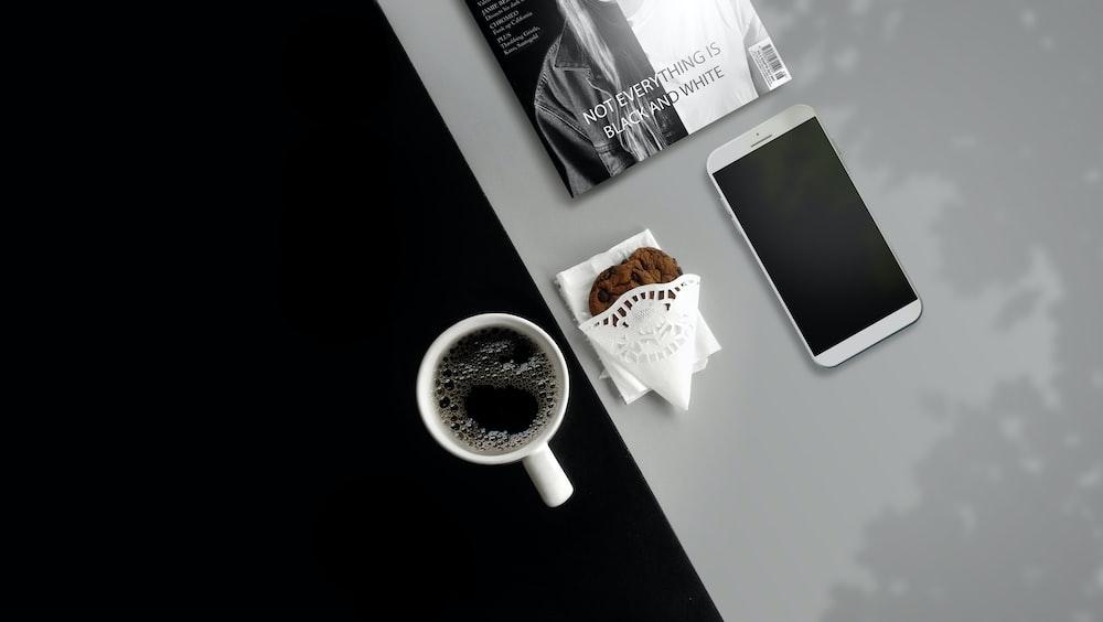 white ceramic mug filled with black liquid
