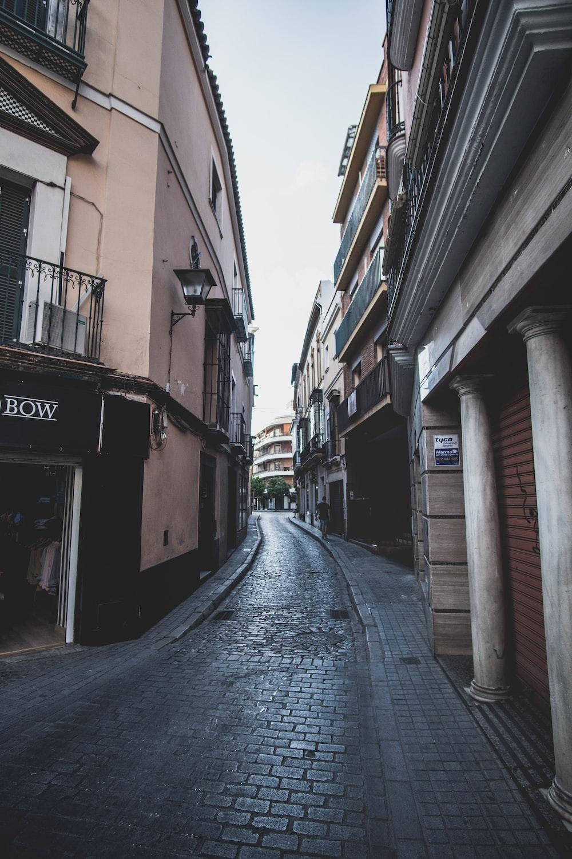 empty street in between of buildings during daytime