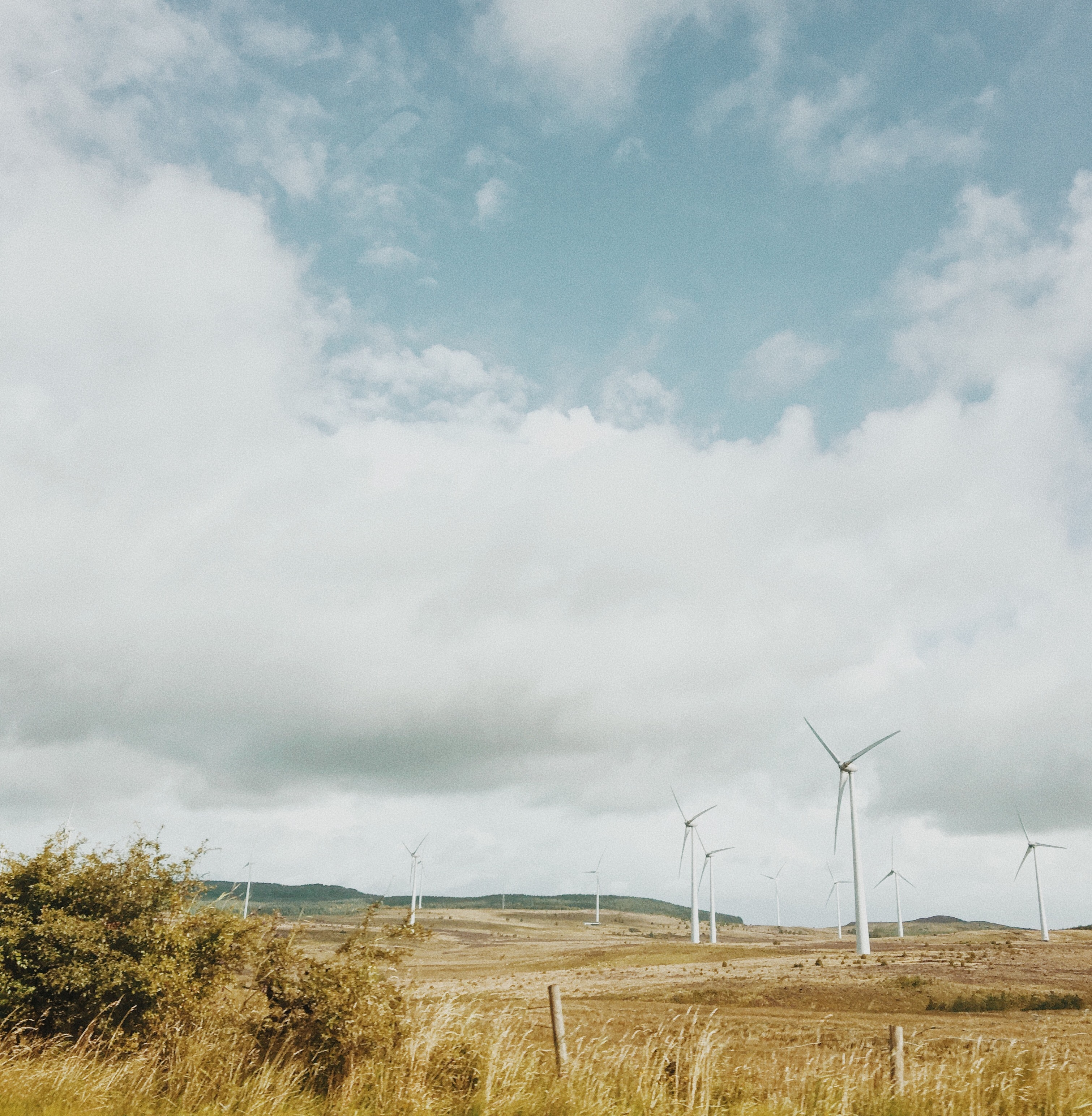 landscape photography of white wind mills