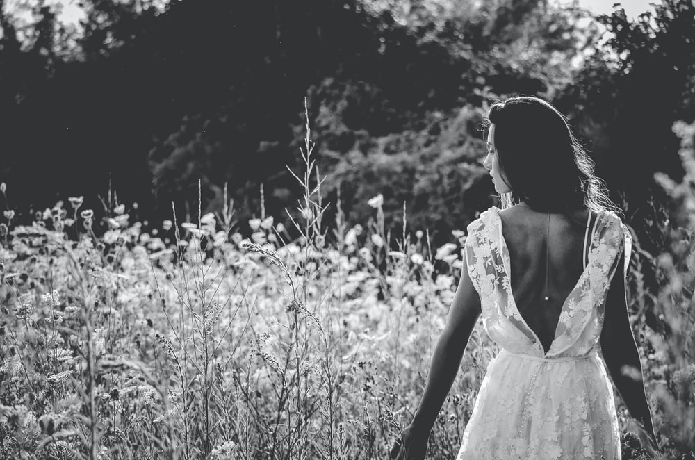grayscale photography of woman in backless wedding gown