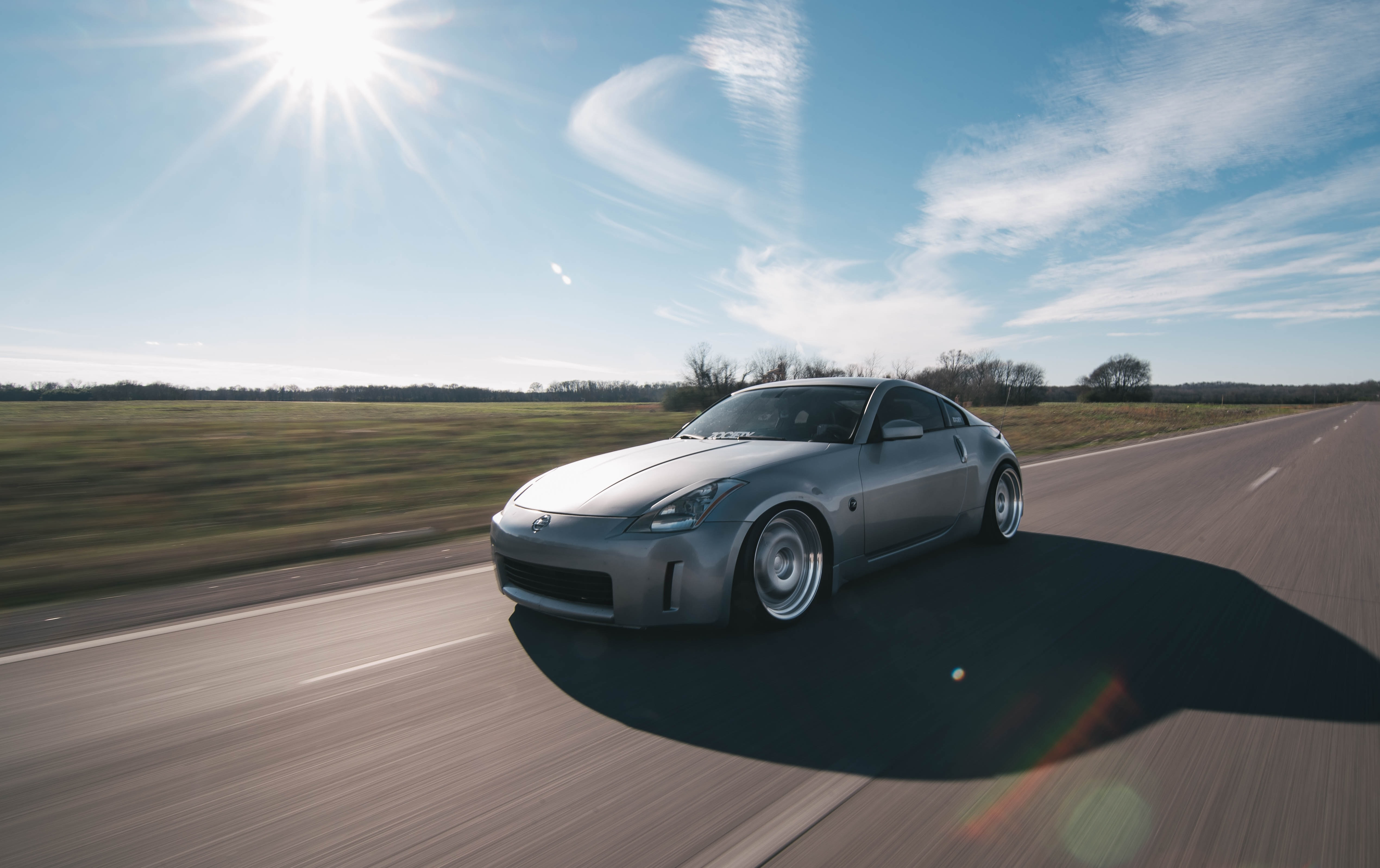 photo of gray coupe on road at daytime