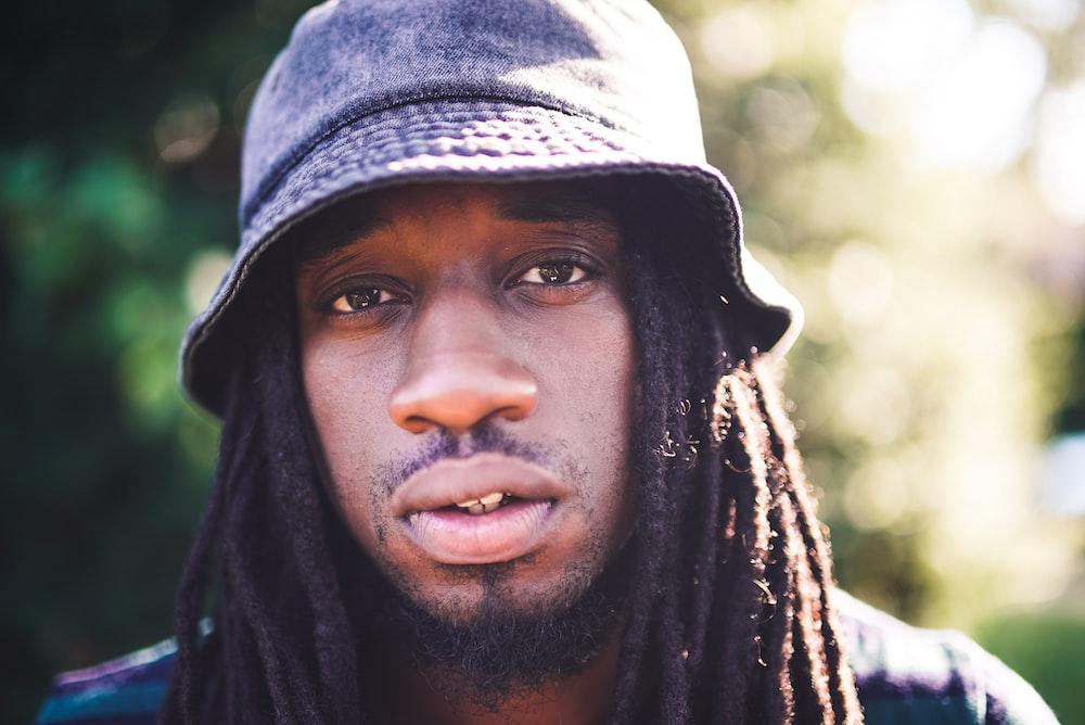 portrait photography of man with dreadlocks