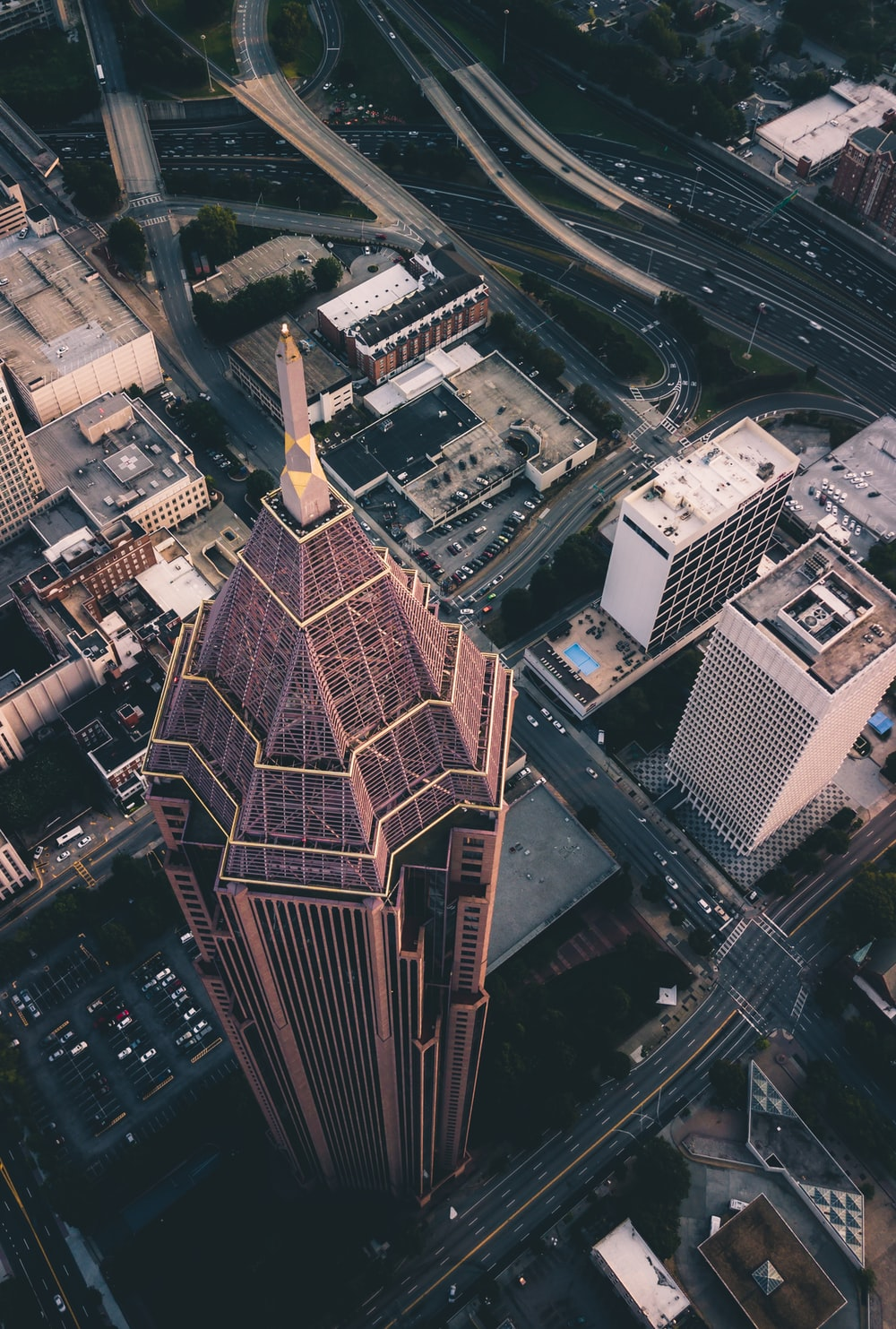 high-angle photography of high-rise building and concrete road